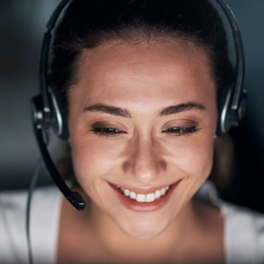 Smiling woman in white with headphones